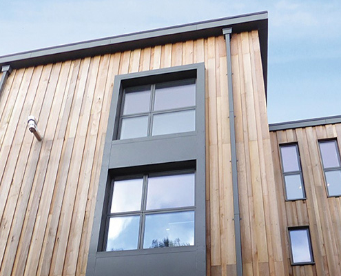 Aluminium box gutter and square downpipe for modern apartments