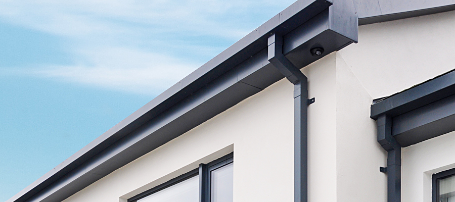 Black square aluminium downpipe and swan neck fitted to box guttering