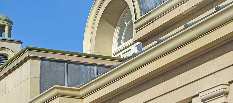 Bespoke large stone effect moulded ogee gutters