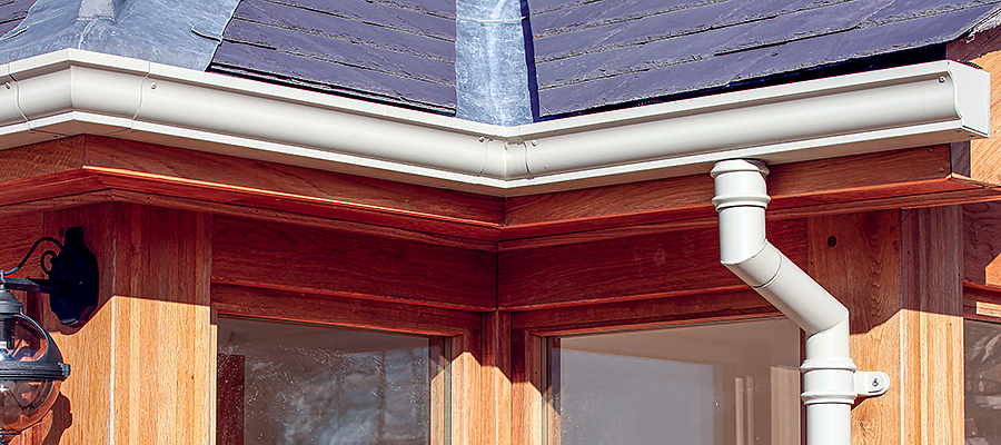 Cream moulded ogee gutters and traditional cast round swan neck