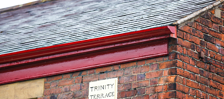Red powder coated aluminium victorian ogee guttering