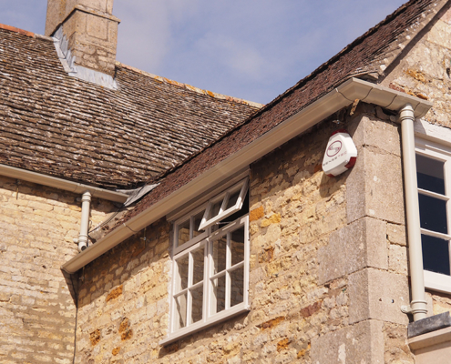 cream victorian ogee guttering and traditional round cast downpipes