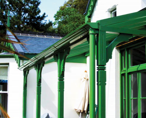 green aluminium victorian ogee gutters with traditional cast downpipes