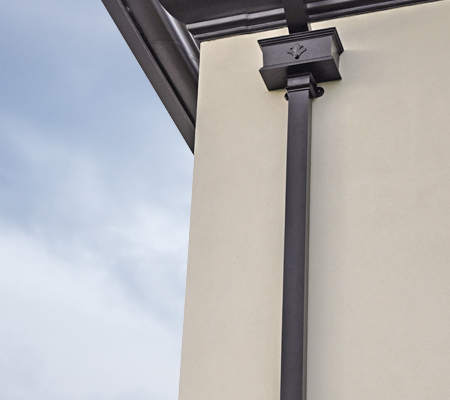 guttercrest aluminium ornate hopperhead in black with moulded ogee guttering and georgian square cast downpipes