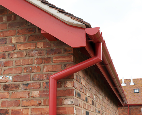 guttercrest aluminium smoothline flush fit joint downpipes fixed to garston barns