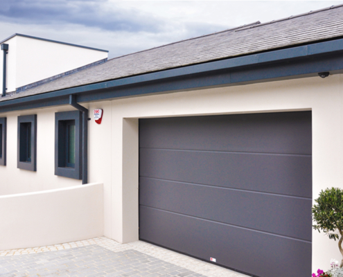 guttercrest aluminium soffit cladding primary duo grey featuring square downpipes and hopper