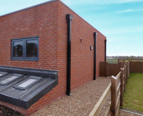 guttercrest aluminium square and rectangular downpipe with hopper in black