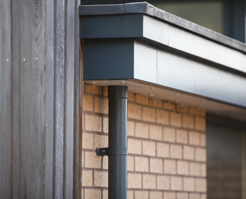 guttercrest aluminium fascia primary trio with round downpipe in grey