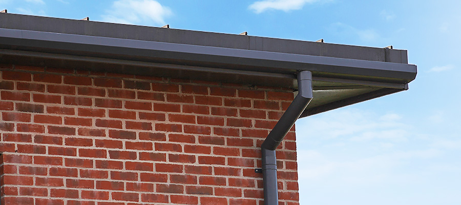 Aluminium shaped box guttering with round downpipe and two piece swan neck